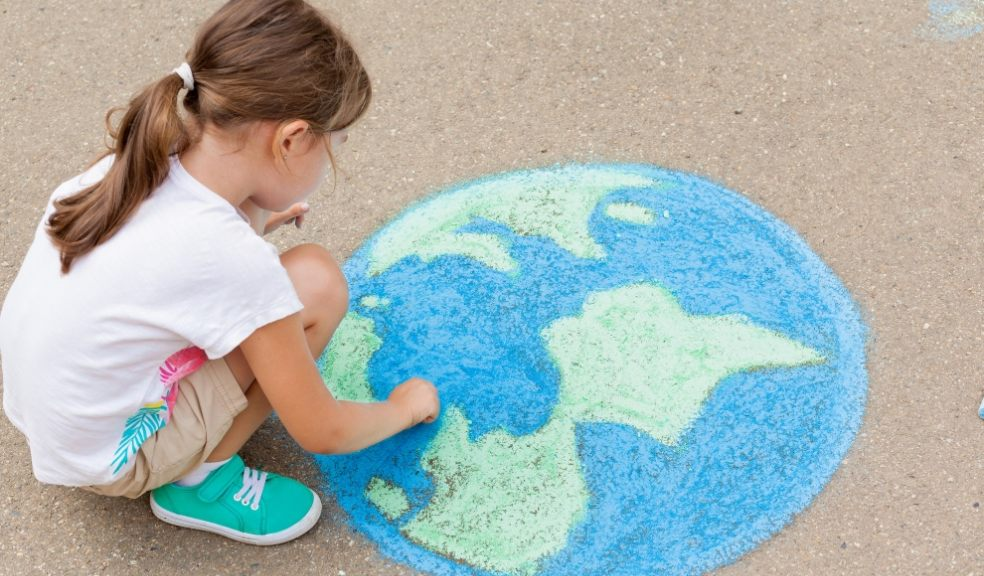 Family. A girl draws a planet of the world with colored chalk on the asphalt. Children's drawings, paintings and concepts. Education and art, be creative when you return to school. earth, Peace day. jpg  PICTURE:Getty Images/iStockphoto