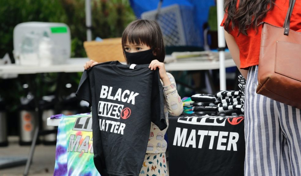 Black lives matter child holding t-shirt