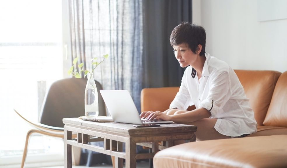 Lady at her laptop worried about money