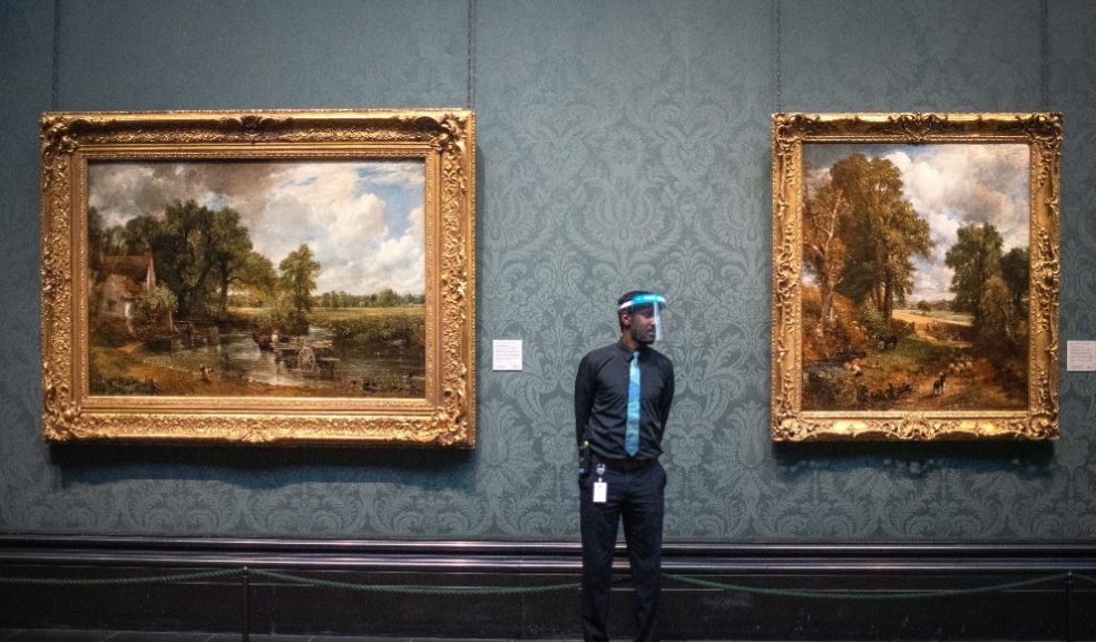 Man wearing PPE at art gallery