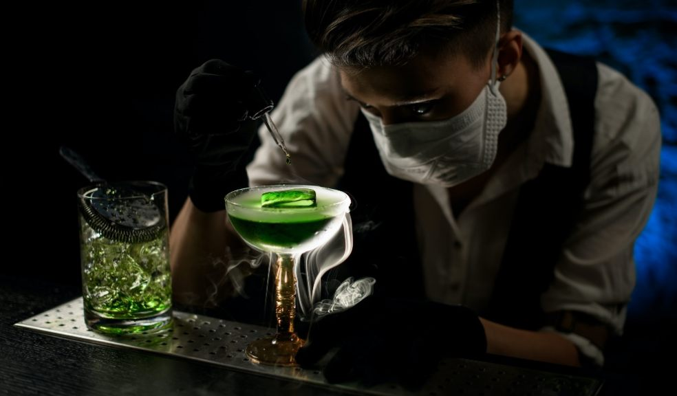 Serving drinks with mask at nightclub