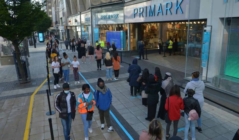 Shoppers queuing outside Primark