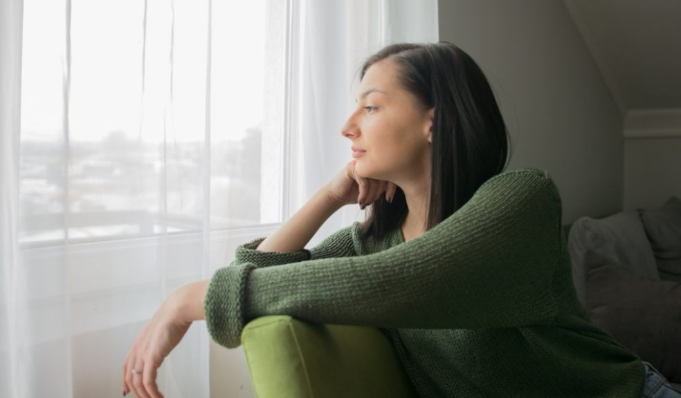 Tenage girl staring out f window. Sad at being alone during Coronavirus. Getty Images/iStockphoto