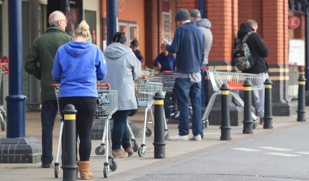 Will supermarket workers be able to keep two metres away from customers? Family (Danny Lawson/PA)