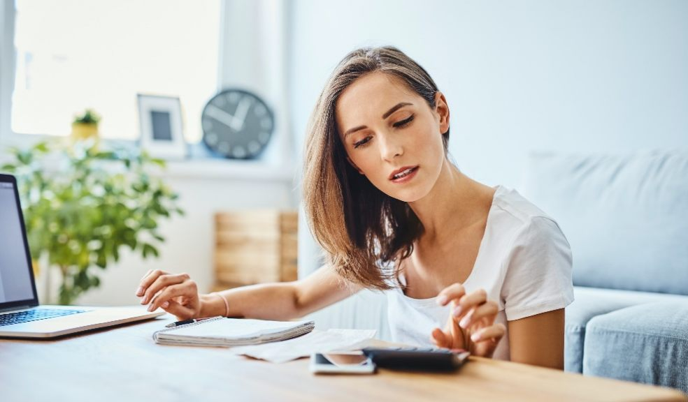 woman with money worries reviewing finances