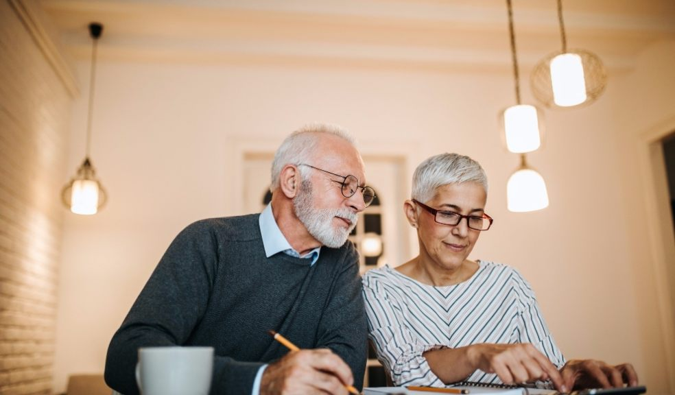 elderly couple checking their home finances