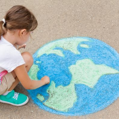 Family. A girl draws a planet of the world with colored chalk on the asphalt. Children's drawings, paintings and concepts. Education and art, be creative when you return to school. earth, Peace day. jpg  PICTURE: Getty Images/iStockphoto