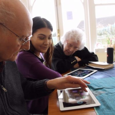 Clients at Peggy Dodd day centre using the MindHarp
