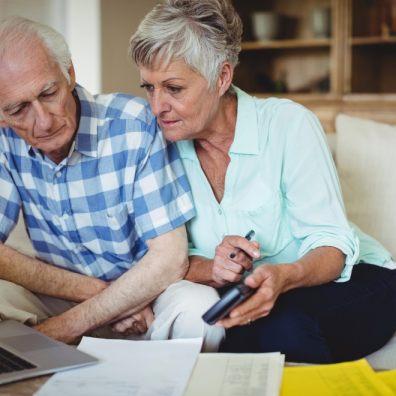Couple checking laptop. Coronavirus scam. Fraudsters.