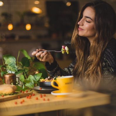 Lady eating at restaurant