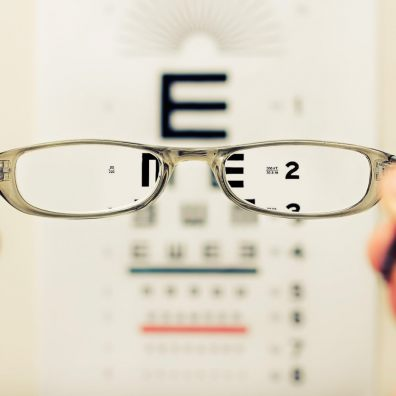 Glasses in front of an eye test chart
