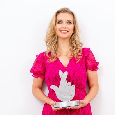 Rachel Riley holding award