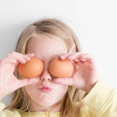 Young girl preparing to cook for her family with eggs.