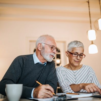 elderly couple checking their home finances